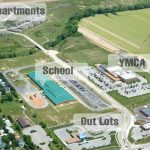 This 120-plus acre mixed-use development includes a 25,000-plus square foot retail center, three free-standing out parcels, an elementary school, a YMCA and a large apartment complex.